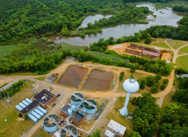 Top aerial view of purification tanks of modern wastewater treatment processing plant