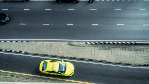 Top aerial view of road and street pedestrian with the car in the city.