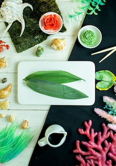 Top  bamboo leaf with ginger and wasabi