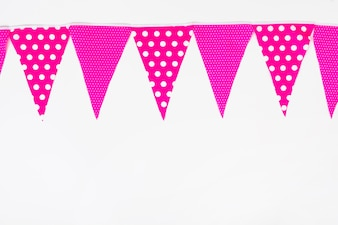 Top bottom made with pink bunting flag on white backdrop