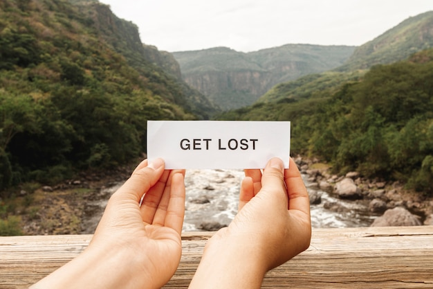 On top of bridge paper sheet with get lost message