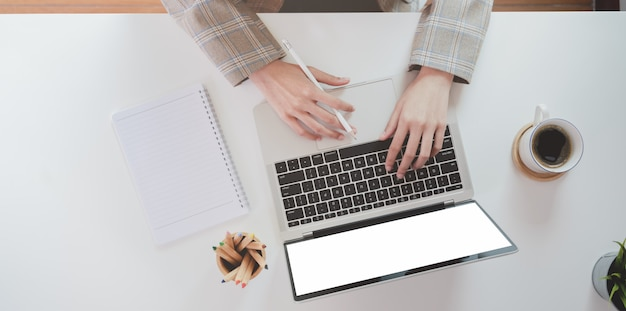Top  of businesswoman hand typing on laptop computer
