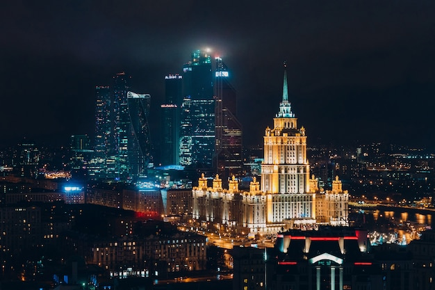 Top cityscape view at night to moscow city and hotel ukraine from new arbat, russia