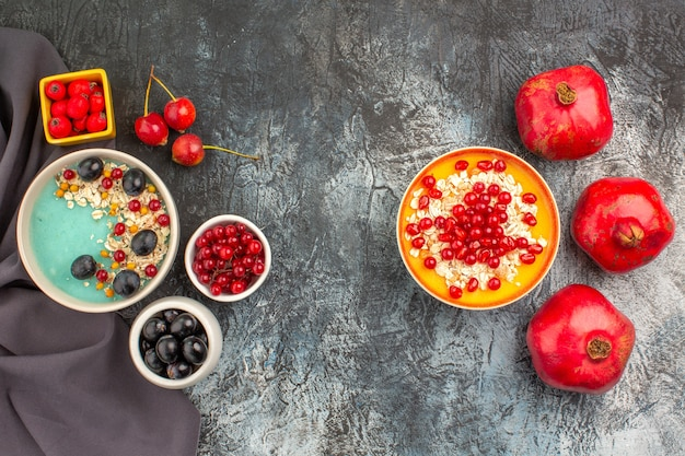 Top close-up view berries oatmeal colorful berries on the tablecloth seeds of pomegranates