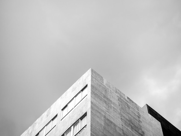 The top corner of a modern concrete building