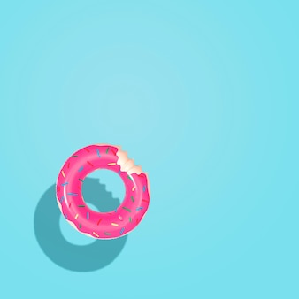 Top down aerial view of summer float doughnut inflatable toy in pool.