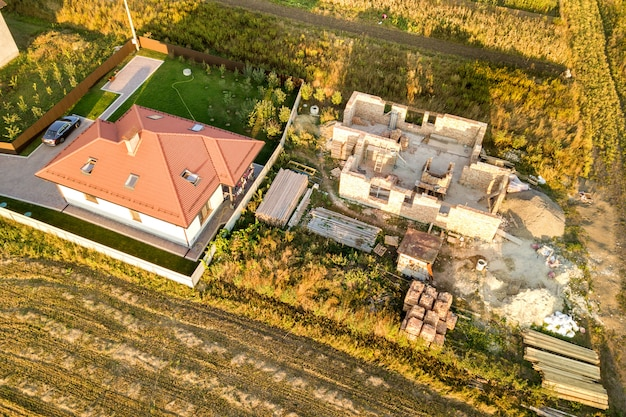 Top down aerial view of two private houses under construction with concrete foundament