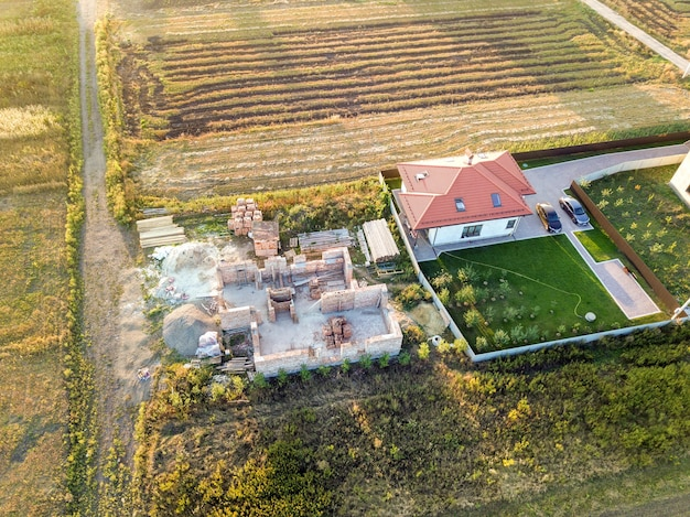Top down aerial view of two private houses