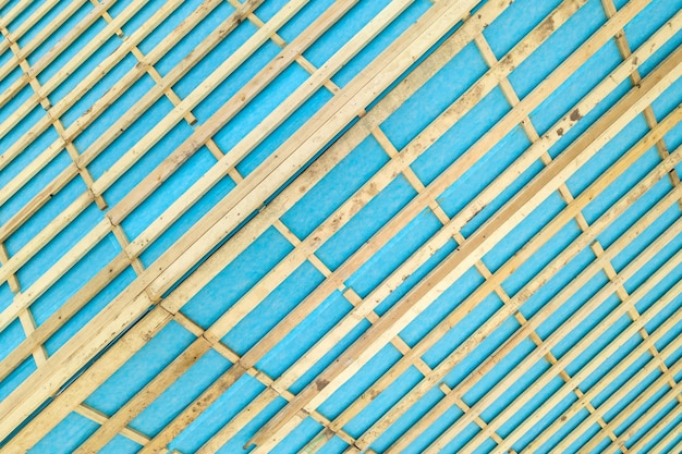 Top down detail of a wooden roof frame on a house under construction.