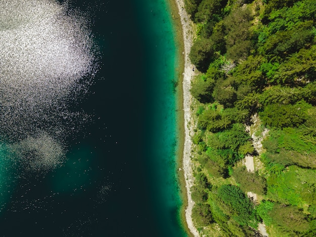 Top down view of the banks of the eibsee in the bavarian alps