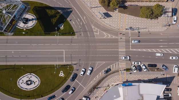 Top down view of urban road traffic, roundabout, junction route traffic with copyspace