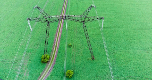 Top electric high voltage post energy transmission voltage post voltage tower in green field