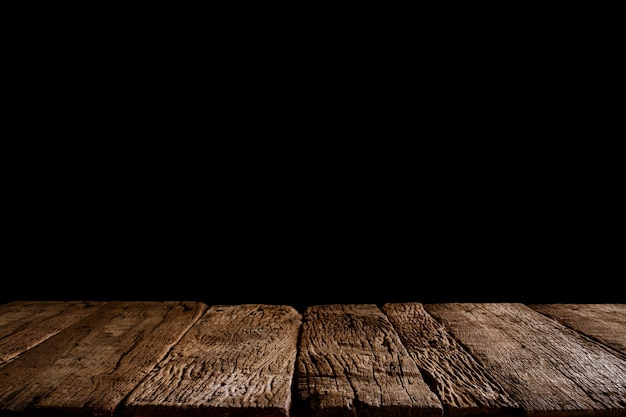 Top of empty wood table ready for your product display or montage. black background