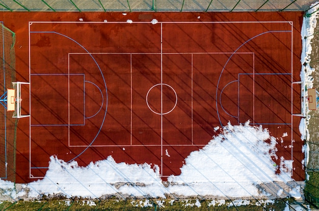 Top graphic view of basketball, volleyball or football court field red background, drone photography.