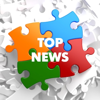 Top news on multicolor puzzle on white background.