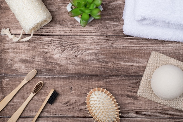 Top above overhead view photo of eco bath products and a succulent isolated on wooden background making center empty copyspace