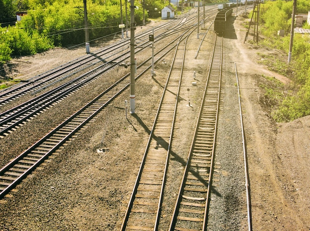 Top perspective view of railway with crossing rail metal tracks at sunny day