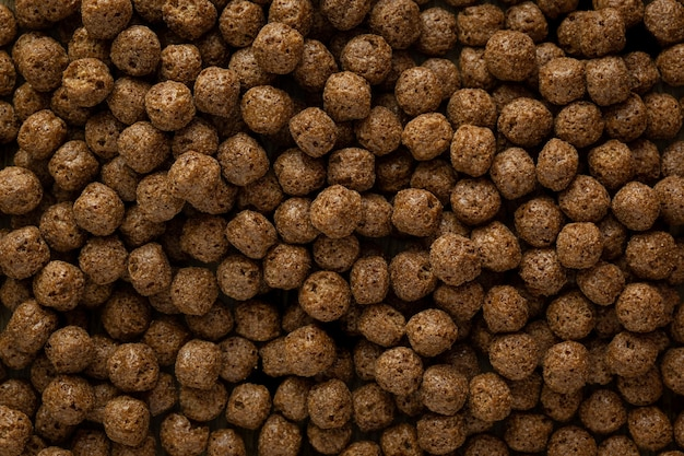 Top photo of spherical shaped chocolate cereal grains