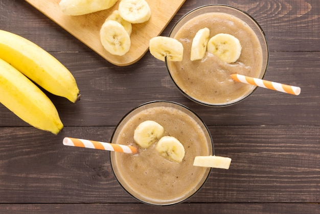 Top shot banana smoothie on wooden background