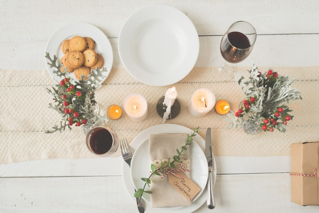 Top shot of beautifully arranged christmas dinner table