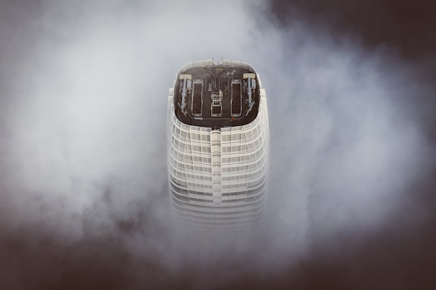 The top of the tallest building in san francisco enveloped with clouds