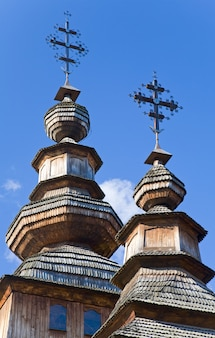 Top of ukrainian historical country wood church on blue sky