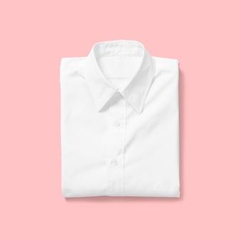 분홍색 배경에 고립 접힌보기 흰 셔츠를 위로 가기. 디자인 프로젝트에 적합합니다.