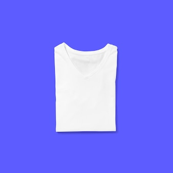 Top up up view white v neck t shirt folded isolated on blue background. suitable for your design project.