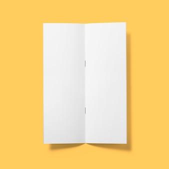 トップアップビュー空白の白いパンフレット垂直逆さま開いて明るい茶色の背景で隔離。