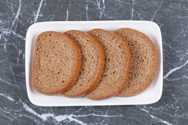 Top up view of fresh rye bread slices.