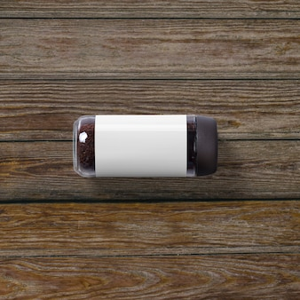 Top up view of jar instant coffee isolated on wooden background