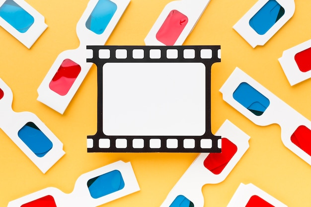 Top view 3d glasses arrangement on yellow background close-up