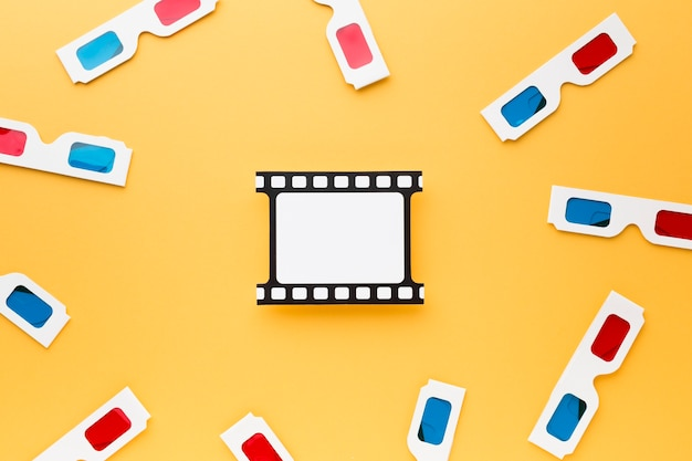 Top view 3d glasses arrangement on yellow background