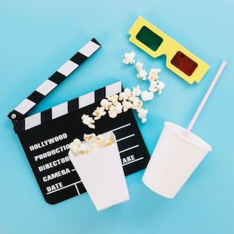Top view 3d glasses with clapperboard and popcorn