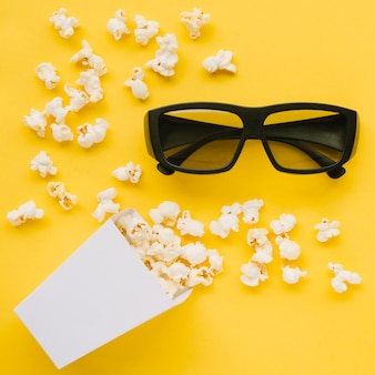 Top view 3d glasses with tasty popcorn
