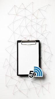 Top view of 5g wi-fi symbol with clipboard