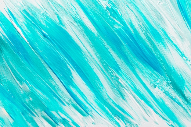 Top view of abstract blue paint brush strokes on surface