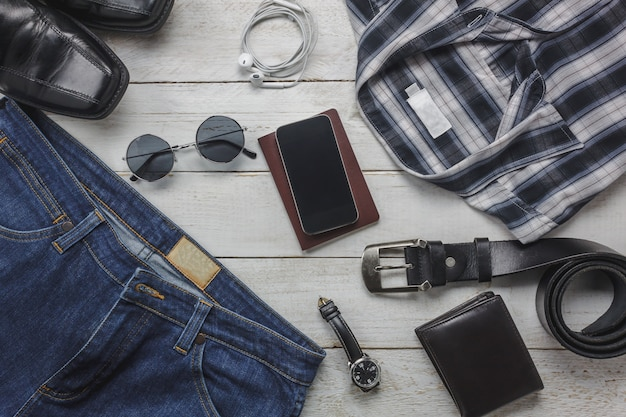 Top view accessoires to travel with man clothing concept. shirt,