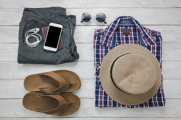 Top view accessoires to travel with man clothing concept