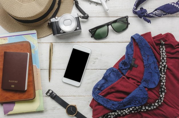 Top view accessoires to travel with women clothing