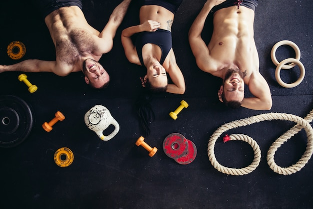 Top view of accessories for fitness and tree athlete lying on floor