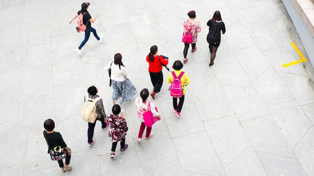 Top view aerial of people walk in pedestrian street