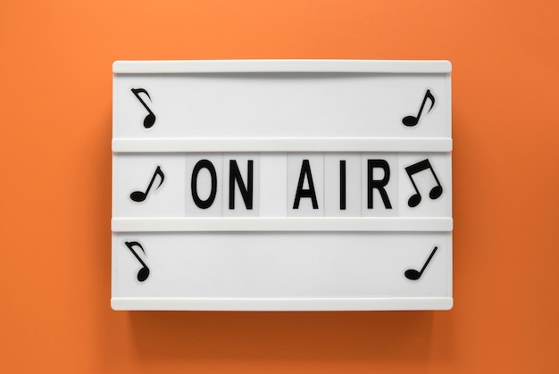 Top view on air sign with orange background