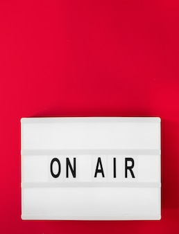 Top view on air sign with red background