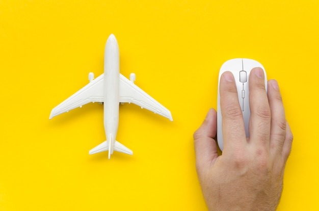 Top view airplane beside hand with mouse