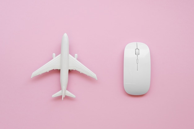 Top view airplane beside mouse