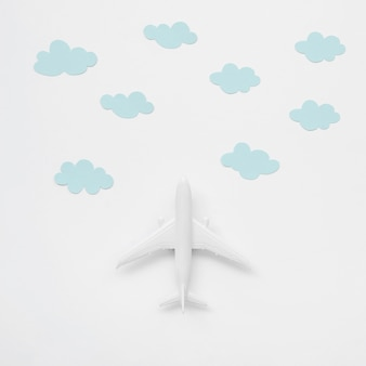 Top view airplane toy with clouds