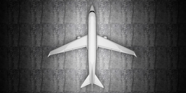 Top view of airplane waiting on concrete floor at hangar