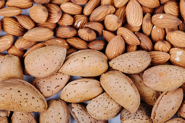 Top view of almond nuts on white background