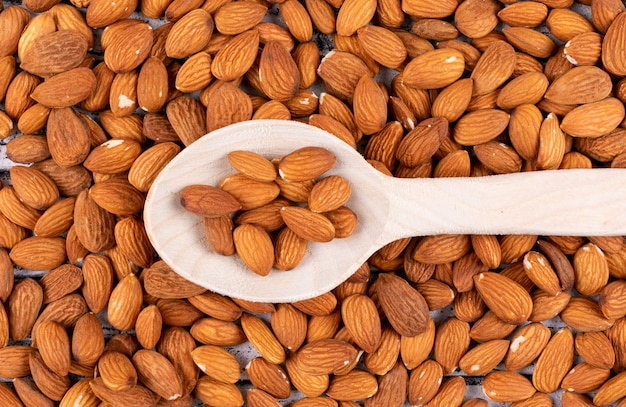 Top view almond in wooden spoon